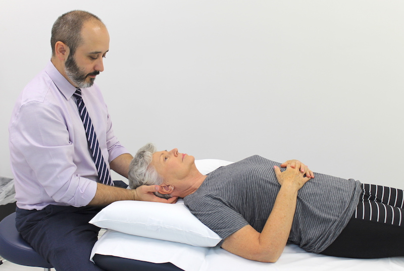 a doctor holding his patients head