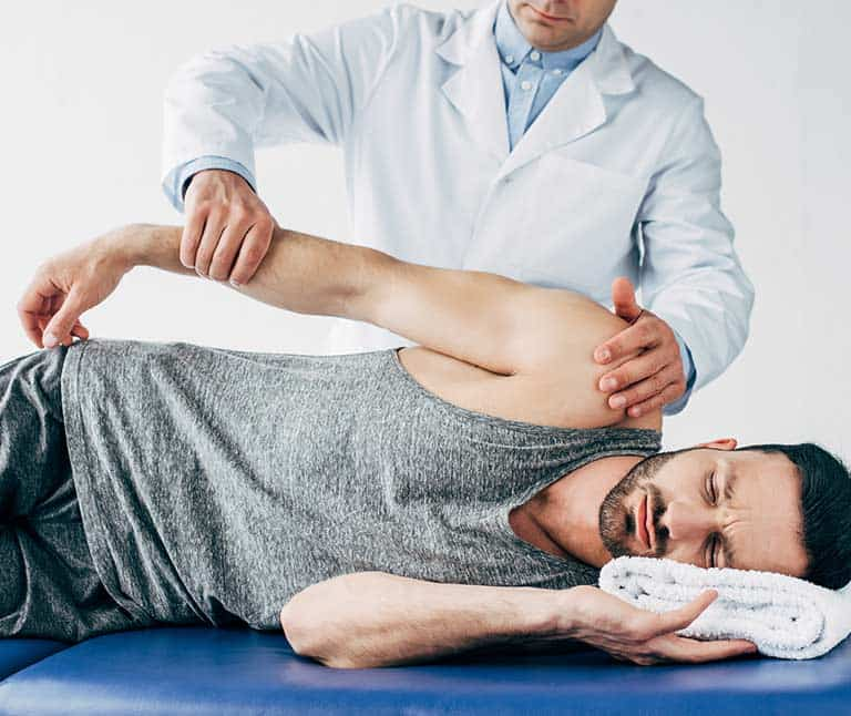 a doctor holding the patient's right arm