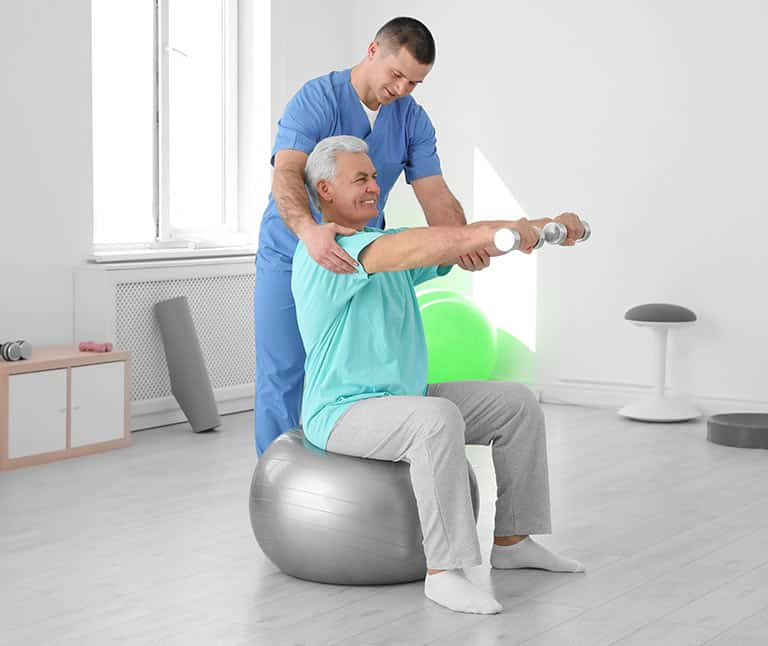 a doctor conducting a physical therapy on a patient
